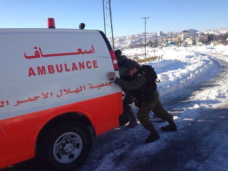 idf-soldiers-helping-palestinian-ambulance-snow-gaza