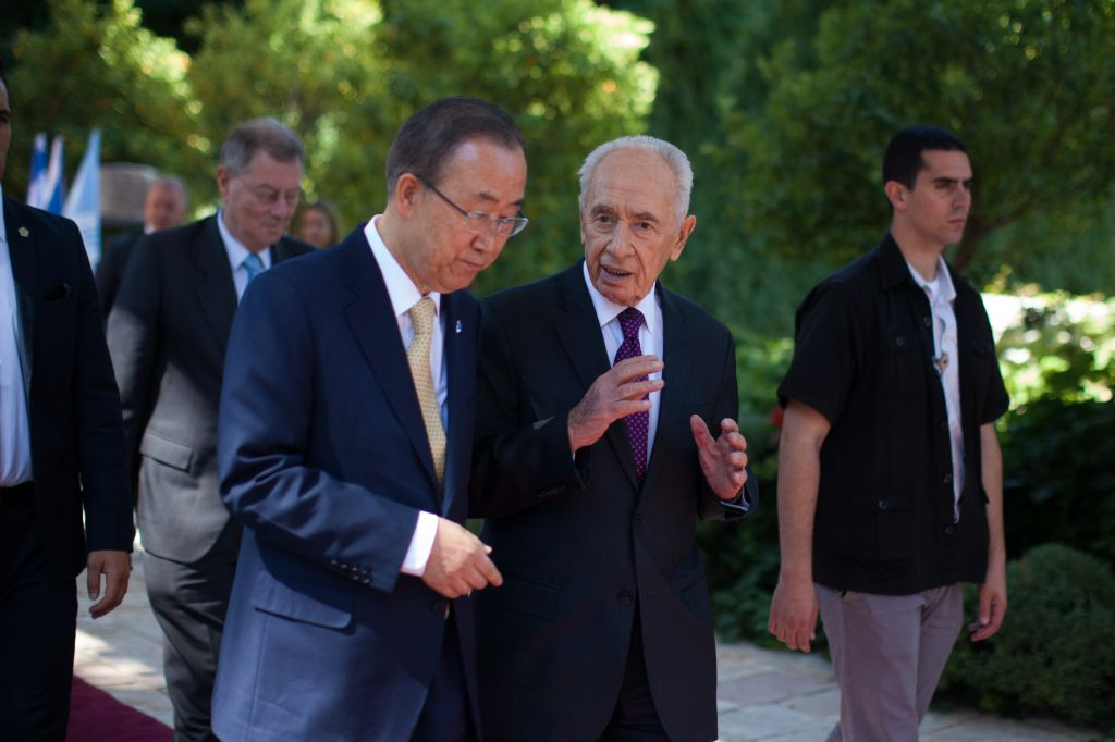 United Nations Secretary-General Ban Ki-moon speaks with Israel's President Shimon Peres after a joint press conference at the president's residence in Jerusalem, Wednesday, July 23, 2014. (Photo credit: Yonatan Sindel/Flash90)
