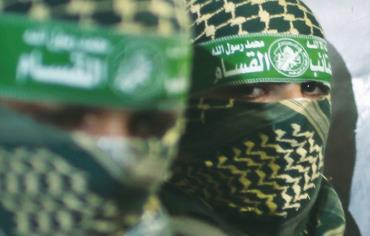 Hamas members are seen close up during a press conference in the Gaza Strip last week. Photo: REUTERS