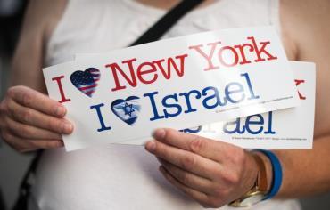 A pro-Israel demonstrator holds up stickers.Photo: ANNA HIATT