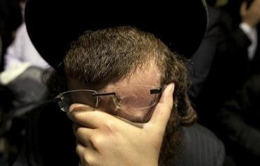 An Orthodox man weepsPhoto: REUTERS/Lucas Jackson