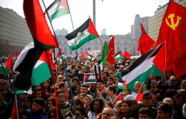 Supporters and members of the Palestine community attend a rally for peace in Gaza, in Santiago, August 9, 2014.Photo REUTERS