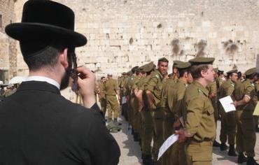 Haredi man overlooking IDF ceremony - Photo: Marc Israel Sellem