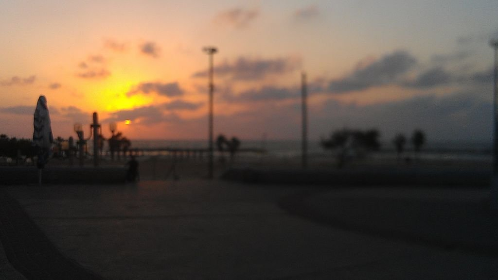 The sun sets over Delilah Beach in Ashkelon on Tuesday. (photo credit: Melanie Lidman/Times of Israel)
