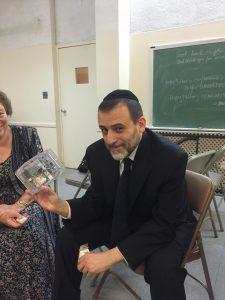 R' Menashe Kelati demonstrating how the Kosher switch works. Courtesy of Shmuel Hertzfeld on Facebook (http://on.fb.me/1G8j854)